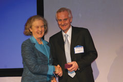 Professor Henry Dargie receives a medal from Mrs Mary Poole-Wilson after presenting the Philip Poole-Wilson memorial lecture