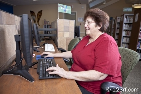 10625402-woman-using-library-computer