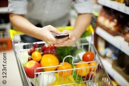 18120243-man-texting-during-shopping